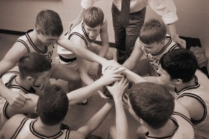 Basketball Team in Huddle