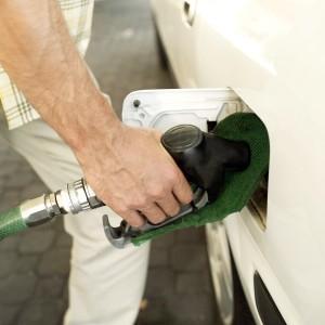 Young Man Filling Petrol Into a Car Petrol Tank