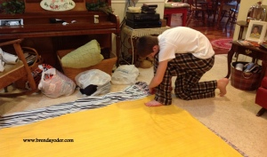Son making the fleece blanket